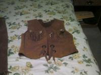 We Have a Leather Skirt and Vest for sale needs a new