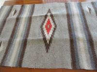 This very desirable weaving  is  beautiful soft wool,