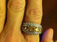 This ring has 5 natural citrine stones, is sterling