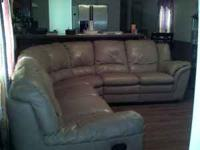Very large leather sectional will seat 7-8 comfortably.