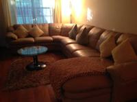This is a beautiful Natuzzi Leather Sectional.   Tan