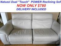 Right here is a Stunning Dual Power Reclining Sofa by