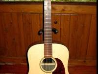 Near Mint Martin DXM Dreadnaught Guitar with stand.
