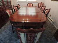 Large carved dining room table, 12 upholstered chairs,