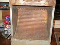Very old, Griswold space heater. Needs cleaned up! One