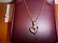 Two necklaces for sale. One is a heart with bagettes