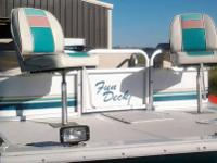 This is a 1994 Hurricane 22 foot deck boat with a 2003