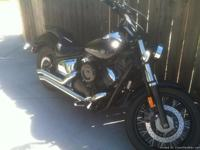 THIS IS A 2009 V STAR CUSTOM 1100 WITH AFTER MARKET BUB