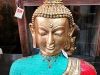 This bronze Buddha with blue turquoise and red coral