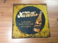 For Sale we have a Metal Nesbitt's Orange Soda Sign!