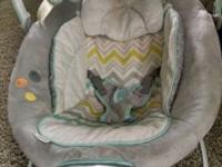 Included is a baby bouncer, nursing pillow, baby bath