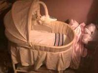 Its a neutral baby bassinet. Lightly used. great