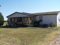 Well maintained manufactured home on 4.27 ag exempt