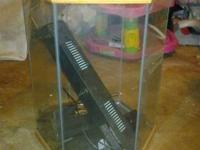 I have a 30 gal hex aquarium. Never used. It comes with