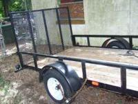 brand new trailer with new tires and front mounted tool