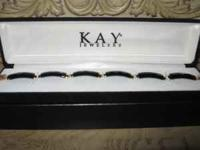 PLEASE CALL  PURCHASED AT KAY JEWELERS / FOUND ONE