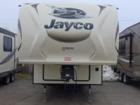 The 2015 Eagle HT26.5RLS is a fifth wheel that has two