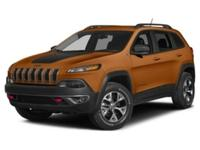 Body Style: SUV Exterior Color: Mango Tango Pearlcoat