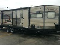 As you enter the Cherokee 274VFK travel trailer by