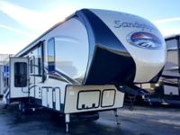 This rear entertainment layout Sandpiper fifth wheel is