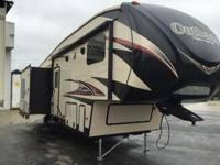 This Keystone Outback 286FRL fifth wheel features a