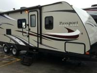 This Keystone Passport Grand Touring travel trailer