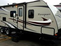 This Grand Touring Passport travel trailer model 2670BH