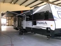 This Palomino Puma travel trailer provides a spacious