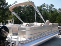 Lovely Cypress Cay 220 Cabana powered by a Mercury 115
