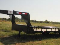 This is a NEW 24x82 Gooseneck tandem axle trailer by