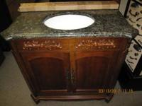 "This very stylish and ornate 36"" bathroom vanity comes"