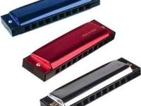New 4 inch metal Harmonicas made by Toysmith. $2.50