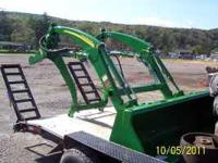a brand new john deere 400x loader complete with mounts