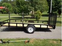 This is a 6.4x14 Utility Trailer that has a drop gate
