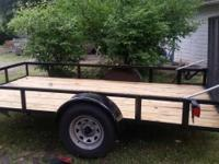 We have a new 6.5 X 12' utility trailer .Has helper