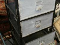 This 4 drawer metal cabinet is NEW and is made to look