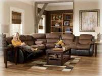 THIS IS ONE OF 'ASHLEY'S LARGEST SECTIONALS. FEATURES