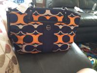 Brand new coach purse and wristlet. Purchased in
