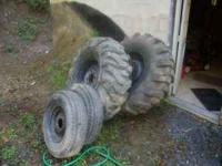 FOR SALE - 2 16.9x24 backhoe tires, rims, and chains