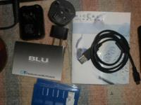 Blu cell phone in case with manual and all adapters for