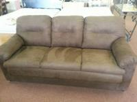 Brown microfiber sofa and love seat $450. These are