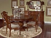 This large walnut dining table has beautiful wood inlay