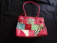 I am selling a new C M handbag model number CM1406P -
