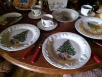 New in box xmas dishes. 8 piece setting I think.