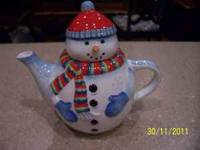 This is a new beautiful Snowman teapot very colorful