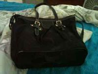 BRANDE NEW COACH PURSE ONLY USED ONCE. BLACK WITH A