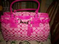 BRAND NEW PINK COACH PURSE. CALL  Location: COLUMBIA