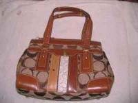 new with tags coach purse... tag was taken off but