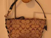 I am selling a signature collection coach purse for