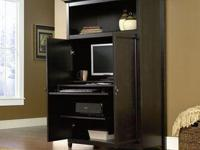 Space-saving cabinet conceals monitor, printer, CPU,